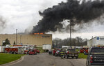 FILE - In this May 2, 2018, file photo, emergency personnel respond to a fire at Meridian Magnesium Products of America in Eaton Rapids, Mich. The fire that damaged the auto parts supply factory is causing production problems at Ford, Fiat Chrysler and General Motors, but it's too soon to tell yet whether dealers will run short of vehicles. So far Ford has been hit hardest by parts shortages. (Matthew Dae Smith/Lansing State Journal via AP, File)