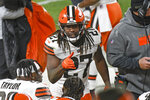 Cleveland Browns running back Kareem Hunt (27) celebrates as he returns to the sideline after scoring on an eight-yard run during the first half of an NFL wild-card playoff football game against the Pittsburgh Steelers in Pittsburgh, Sunday, Jan. 10, 2021. (AP Photo/Don Wright)
