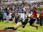 Northern Illinois wide receiver Jauan Wesley, right, can't make a catch as UAB cornerback Starling Thomas V (4) defends during the first half of the Boca Raton Bowl NCAA college football game, Tuesday, Dec. 18, 2018, in Boca Raton, Fla. (AP Photo/Lynne Sladky)