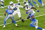 Detroit Lions running back Adrian Peterson, right, rushes during the second half of an NFL football game against the Indianapolis Colts, Sunday, Nov. 1, 2020, in Detroit. (AP Photo/Carlos Osorio)