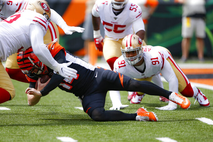 Cincinnati Bengals quarterback Andy Dalton (14) is sacked by San Francisco 49ers defensive end Arik Armstead (91) during the first half an NFL football game, Sunday, Sept. 15, 2019, in Cincinnati. (AP Photo/Gary Landers)