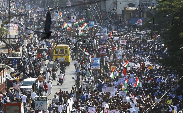 Indians march during a protest against the Citizenship Act in Mumbai, India, Wednesday, Dec. 18, 2019. India's Supreme Court on Wednesday postponed hearing pleas challenging the constitutionality of the new citizenship law that has sparked opposition and massive protests across the country. (AP Photo/Rajanish Kakade)