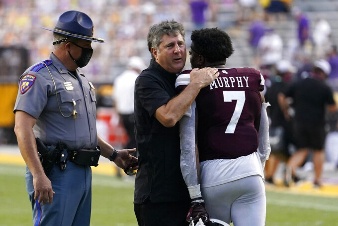 Mississippi State head coach Mike Leach hugs safety Marcus Murphy (7) after an NCAA college football game against LSU in Baton Rouge, La., Saturday, Sept. 26, 2020. Mississippi State won 44-34. (AP Photo/Gerald Herbert)