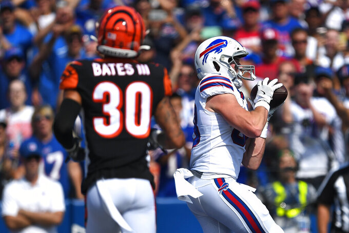 CORRECTS DATE - Buffalo Bills' Dawson Knox, right, catches a pass for a touchdown during the first half of an NFL football game as Cincinnati Bengals free safety Jessie Bates (30) watches Sunday, Sept. 22, 2019, in Orchard Park, N.Y. (AP Photo/Adrian Kraus)