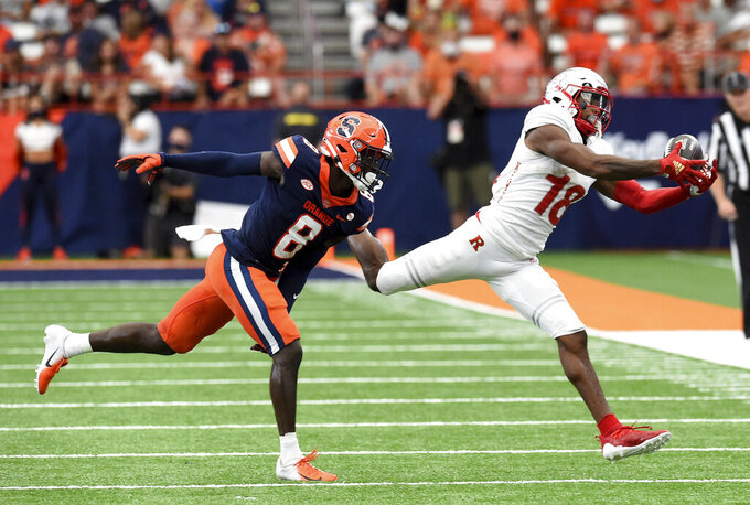 Syracuse defensive back Garrett Williams (8) chases down Rutgers wide receiver Bo Melton (18) in the second half  of an NCAA college football game, Saturday, Sept. 11, 2021, at the Carrier Dome in Syracuse, N.Y. (Dennis Nett/The Post-Standard via AP)