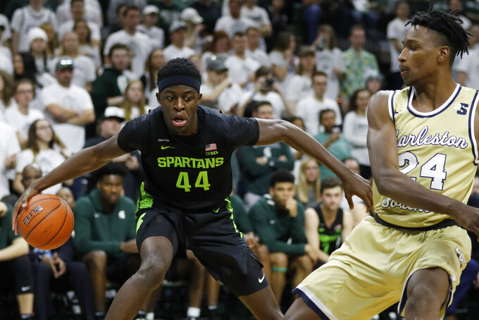 Michigan State forward Gabe Brown (44) controls the ball as Charleston Southern guard Phlandrous Fleming Jr. (24) defends during the second half of an NCAA college basketball game, Monday, Nov. 18, 2019, in East Lansing, Mich. (AP Photo/Carlos Osorio)
