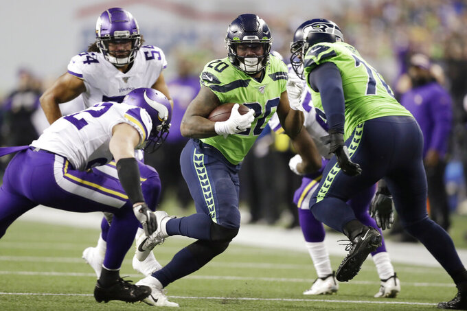 Seattle Seahawks' Rashaad Penny (20) carries against the Minnesota Vikings during the first half of an NFL football game, Monday, Dec. 2, 2019, in Seattle. (AP Photo/John Froschauer)