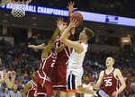 Virginia's Kyle Guy (5) shoots while defended by Oklahoma's Aaron Calixte (2) and Matt Freeman (5) during the second half of a second round men's college basketball game in the NCAA Tournament in Columbia, S.C. Sunday, March 24, 2019. (AP Photo/Richard Shiro)