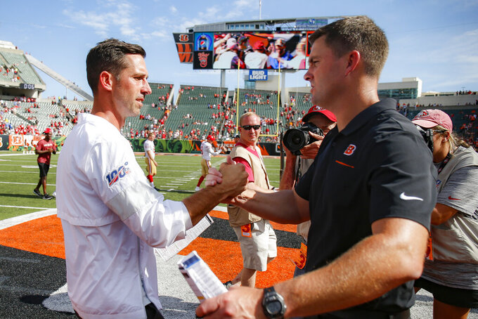 San Francisco 49ers head coach Kyle Shanahan, left, meets with Cincinnati Bengals head coach Zac Taylor, right, after an NFL football game, Sunday, Sept. 15, 2019, in Cincinnati. The 49ers won 41-17. (AP Photo/Gary Landers)