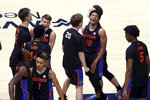 Florida players celebrate after a win against West Virginia during the second half of an NCAA college basketball game Saturday, Jan. 30, 2021, in Morgantown, W.Va. (AP Photo/Kathleen Batten)