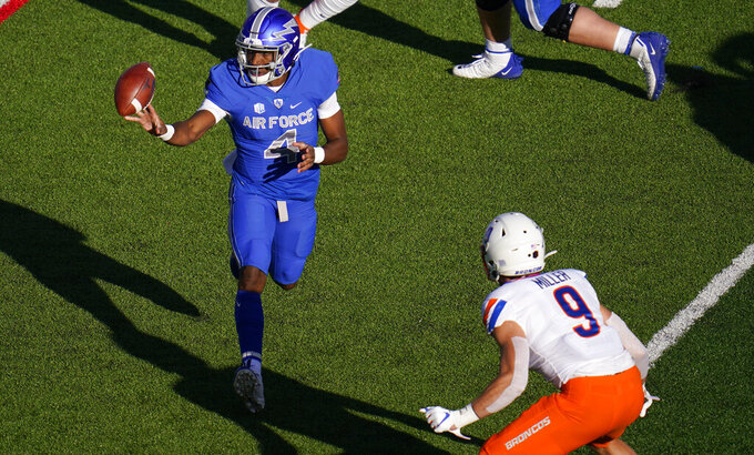 Air Force quarterback Haaziq Daniels, left, pitches the ball as Boise State linebacker Brock Miller defends during the first half of an NCAA college football game Saturday Oct. 31, 2020, at Air Force Academy, Colo. (AP Photo/David Zalubowski)