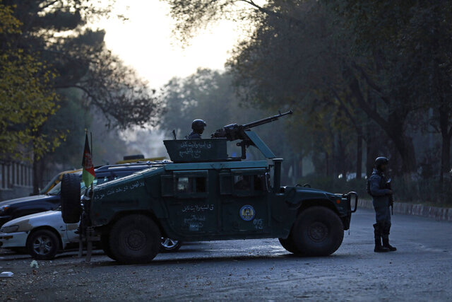 Afghan police patrol at the site of an attack at Kabul University in Kabul, Afghanistan, Monday, Nov. 2, 2020. The brazen attack by gunmen who stormed the Kabul University has left many dead and wounded in the Afghan capital. The assault sparked a hours-long gunbattle. (AP Photo/Rahmat Gul)