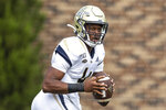 FILE - In this Oct. 12, 2019, file photo, Georgia Tech's James Graham looks to pass during an NCAA college football game against Duke, in Durham, N.C. Georgia Tech has named a starting quarterback but won't publicly say who the player is before Saturday's season opener at Florida State. The leading candidates are James Graham, who started the final eight games last year, and freshman Jeff Sims.  (AP Photo/Ben McKeown, File)