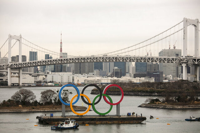 A barge carrying the Olympic Rings floats in the water near the Rainbow Bridge Friday, Jan. 17, 2020, in the Odaiba district of Tokyo. (AP Photo/Jae C. Hong)
