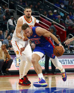Detroit Pistons forward Blake Griffin (23) is fouled by Atlanta Hawks center Alex Len during the first half of an NBA basketball game, Friday, Nov. 22, 2019, in Detroit. (AP Photo/Carlos Osorio)