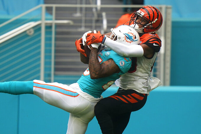Miami Dolphins cornerback Xavien Howard (25) intercepts a pass intended for Cincinnati Bengals wide receiver Tyler Boyd (83) during the first half of an NFL football game, Sunday, Dec. 6, 2020, in Miami Gardens, Fla. (AP Photo/Wilfredo Lee)