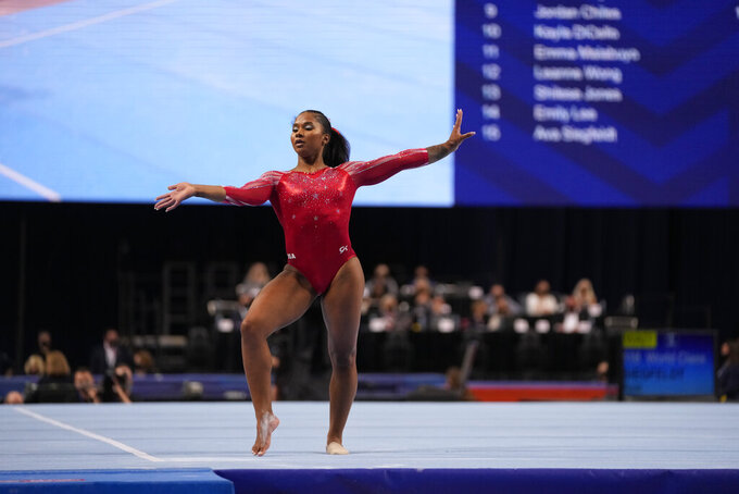 Jordan Chiles competes in the floor exercise during the women's U.S. Olympic Gymnastics Trials Sunday, June 27, 2021, in St. Louis.  For decades, high-profile college-bound Olympians were forced to make a choice: turn pro to cash in on their notoriety or remain an amateur to go to school. That's no longer an issue for athletes like gymnasts Sunisa Lee and Jordan Chiles after legislation cleared the way for them to profit off their Name, Image and Likeness. (AP Photo/Jeff Roberson)