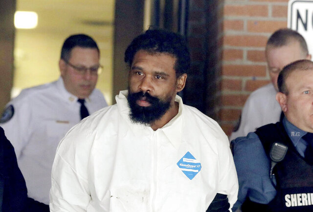 Grafton Thomas is led from Ramapo Town Hall in Ramapo, N.Y. following his arraignment Sunday, Dec. 29, 2019. Thomas was charged in the stabbings of multiple people as they gathered to celebrate Hanukkah at a rabbi's home in Monsey, an Orthodox Jewish community north of New York City.  (Seth Harrison/The Journal News via AP)