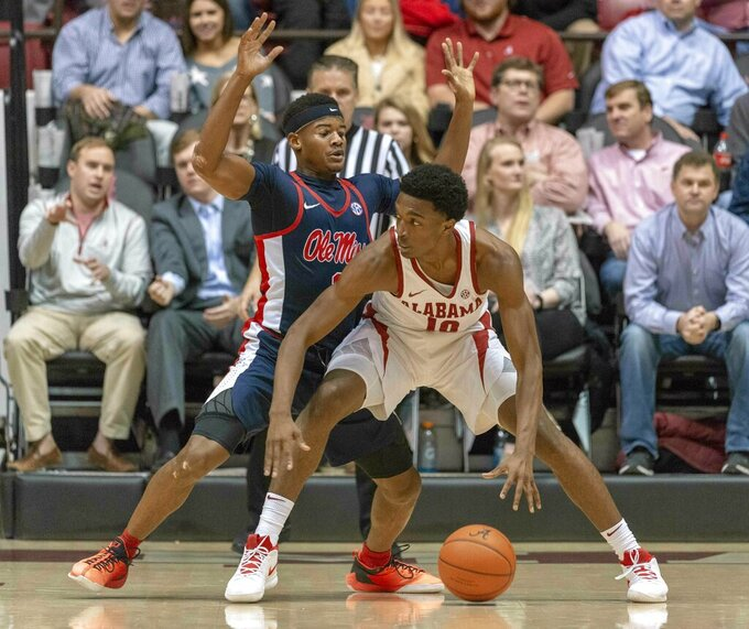 Alabama guard Herbert Jones (10) works inside against Mississippi guard Devontae Shuler (2) during the first half of an NCAA college basketball game, Tuesday, Jan. 22, 2019, in Tuscaloosa, Ala. (AP Photo/Vasha Hunt)