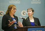 Kristen Kulinowski, right, interim executive director of the U.S. Chemical Safety Board, looks on as investigator Lauren Grim, left, answers a question on their report on the blowout that fatally injured five workers at the Pryor Trust gas well located in Pittsburgh County, Okla., during a news conference Wednesday, June 12, 2019, in Oklahoma City. (AP Photo/Sue Ogrocki)
