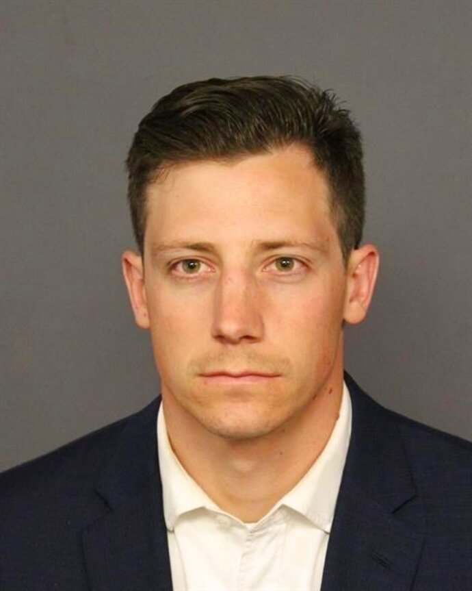 FILE--This undated file photo provided by the Denver Police Department shows Chase Bishop. The off-duty FBI agent who investigators say accidentally fired a weapon that fell while he was dancing at a Denver club and wounded another patron in the leg is allowed to travel while out on bond. Bishop appeared in court Wednesday, June 13, 2018, out of custody after turning himself in Tuesday on a second-degree assault charge. Jail records say Bishop posted bond and was released. (Denver Police Department via AP)