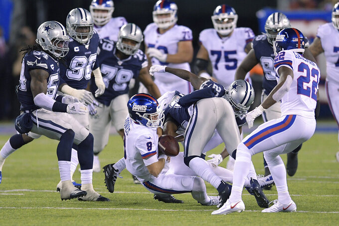 New York Giants quarterback Daniel Jones (8) fumbles the ball for a turnover against the Dallas Cowboys during the third quarter of an NFL football game, Monday, Nov. 4, 2019, in East Rutherford, N.J. (AP Photo/Bill Kostroun)