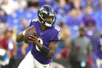 Baltimore Ravens quarterback Lamar Jackson looks to pass against the Jacksonville Jaguars during the first half of an NFL football preseason game Thursday, Aug. 8, 2019, in Baltimore. (AP Photo/Gail Burton)