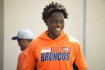 Denver Broncos quarterback Teddy Bridgewater jokes with teammates after taking part in drills at NFL football training camp, Wednesday, July 28, 2021, in Englewood, Colo. (AP Photo/David Zalubowski)