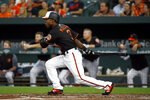 Baltimore Orioles' Cedric Mullins doubles in the second inning of a baseball game against the Boston Red Sox, Friday, Aug. 10, 2018, in Baltimore. Renato Nunez scored on the play. (AP Photo/Patrick Semansky)