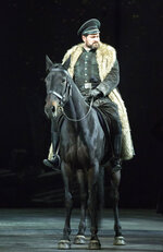 This undated photo made available by La Scala opera theater on Dec. 5, 2018 shows Russian bass Ildar Abdrazakov on a horse performing during a rehearsal of Giuseppe Verdi's