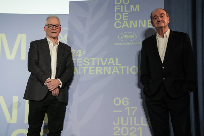 Festival director Thierry Fremaux, left and Festival president Pierre Lescure during the presentation of the official selection of the 74th International Cannes Film Festival, in Paris, Thursday, June 3, 2021. (AP Photo/Francois Mori)