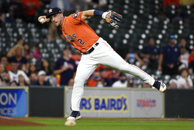 Houston Astros third baseman Alex Bregman throws out Oakland Athletics' Ramon Laureano during the first inning of a baseball game, Friday, April 9, 2021, in Houston. (AP Photo/Eric Christian Smith)