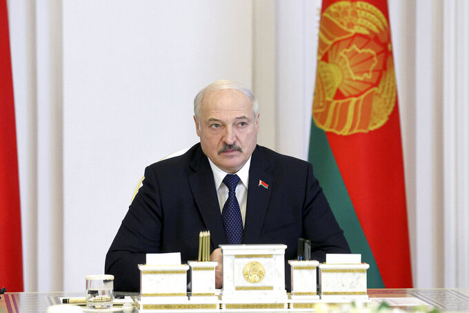 Belarus President Alexander Lukashenko speaks during a cabinet meeting in Minsk, Belarus, Friday, July 23, 2021. Belarusian authorities have ramped up raids and arrests of independent journalists and civil society activists in recent weeks. (Nikolay Petrov/BelTA Pool Photo via AP)
