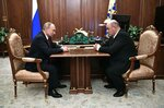 Russian President Vladimir Putin, left, listens to Tax Service chief Mikhail Mishustin during their meeting in the Kremlin in Moscow, Russia, Wednesday, Jan. 15, 2020. Putin has named Tax Service chief Mikhail Mishustin as Russia's new prime minister Wednesday Jan. 15.  The 53-year-old Mishustin has worked in the government since 1998, keeping a low profile while serving as the head of the Federal Tax Service since 2010. (Alexei Nikolsky, Sputnik, Kremlin Pool Photo via AP)