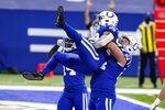 Indianapolis Colts running back Jonathan Taylor (28) celebrates touchdown with offensive guard Mark Glowinski (64) against the Houston Texans in the first half of an NFL football game in Indianapolis, Sunday, Dec. 20, 2020. (AP Photo/Darron Cummings)