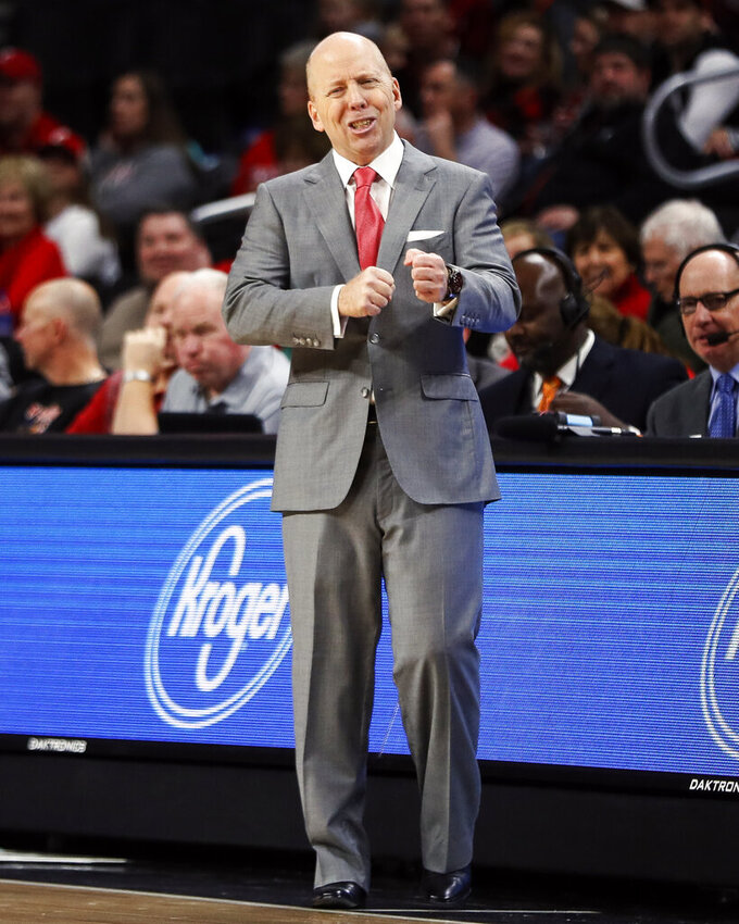 Cincinnati head coach Mick Cronin reacts in the first half of the team's NCAA college basketball game against South Florida, Tuesday, Jan. 15, 2019, in Cincinnati. (AP Photo/John Minchillo)