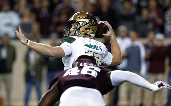 UAB quarterback Tyler Johnston III (17) looks for a receiver as Texas A&M defensive lineman Landis Durham (46) closes in during the first half of an NCAA college football game Saturday, Nov. 17, 2018, in College Station, Texas. (AP Photo/Michael Wyke)