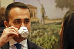Deputy Premier and Labor Minister Luigi Di Maio enjoys a coffee as he arrives for a press conference at the Foreign Press Association headquarters, in Rome, Friday, Nov. 9, 2018. (AP Photo/Andrew Medichini)