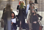 Actress Amber Heard, centre, arrives at the High Court in London for a hearing in Johnny Depp's libel case, Friday July 10, 2020.  Depp is back in the witness box at the trial of his libel suit against a tabloid newspaper that called him a