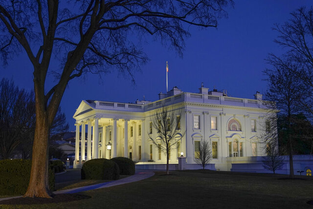 Dusk settles over the White House in Washington, Saturday, Jan. 23, 2021. (AP Photo/Patrick Semansky)