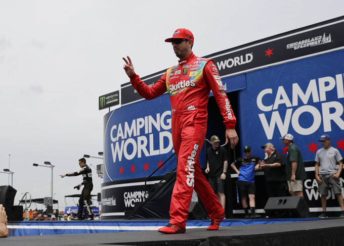 Kyle Busch waves to the crowd during drivers introduction before the NASCAR Cup Series auto race at Chicagoland Speedway in Joliet, Ill., Sunday, June 30, 2019. (AP Photo/Nam Y. Huh)