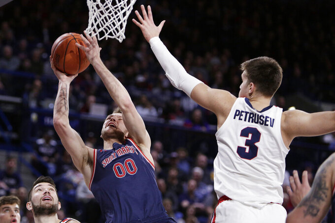 Saint Mary's guard Tanner Krebs (00) shoots next to Gonzaga forward Filip Petrusev (3) during the first half of an NCAA college basketball game in Spokane, Wash., Saturday, Feb. 29, 2020. (AP Photo/Young Kwak)