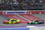 Ryan Blaney (12) beats William Byron (24) at the finish line to win the NASCAR Cup Series auto race at Michigan International Speedway, Sunday, Aug. 22, 2021, in Brooklyn, Mich. (AP Photo/Carlos Osorio)