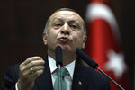 Turkey's President and leader of ruling Justice and Development Party Recep Tayyip Erdogan addresses the members of his ruling party at the parliament in Ankara, Turkey, Tuesday, Feb. 13, 2018. Erdogan issued a warning Tuesday to Greece, Cyprus and international companies exploring for gas in the eastern Mediterranean not to