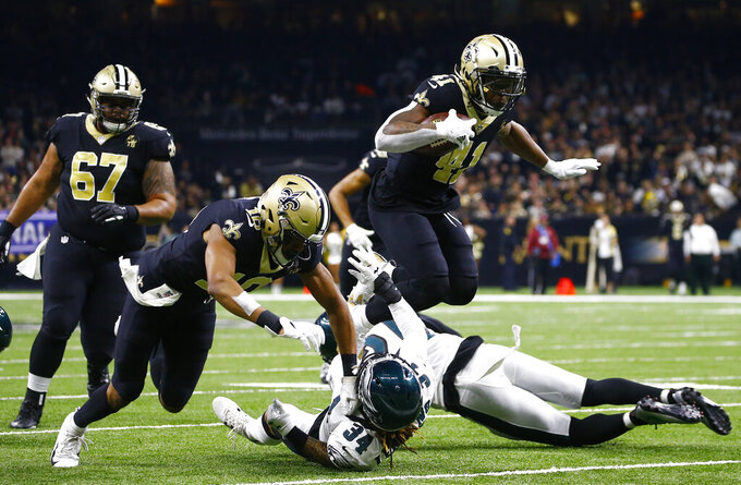 New Orleans Saints running back Alvin Kamara (41) runs against Philadelphia Eagles cornerback Cre'von LeBlanc (34) in the first half of an NFL divisional playoff football game in New Orleans, Sunday, Jan. 13, 2019. (AP Photo/Butch Dill)