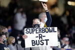 A New Orleans Saints fan holds a sign with Super Bowl aspirations in the second half of an NFL wild-card playoff football game against the Chicago Bears in New Orleans, Sunday, Jan. 10, 2021. (AP Photo/Brett Duke)