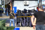 Georgian police gather at a bank where an armed assailant took several people hostage in the town of Zugdidi in western Georgia, Wednesday, Oct. 21, 2020. An armed assailant took several people hostage at a bank in the ex-Soviet nation of Georgia on Wednesday, authorities said. The Georgian Interior Ministry didn't immediately say how many people have been taken hostage in the town of Zugdidi in western Georgia, or what demands the assailant has made. Police sealed off the area and launched an operation
