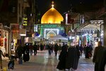 In this Thursday, Feb. 13, 2020 photo, people walk toward the holy shrine of Imam Ali, the son-in-law and cousin of the Prophet Muhammad and the first Imam of the Shiites, in Najaf, Iraq. In recent years, Valentine's in Najaf has emerged as a field of contention. It pitted revelers who see in it harmless fun and personal freedom advocates against conservatives who view it as sacrilege--a foreign celebration that has no place in a holy city like Najaf. (AP Photo/Anmar Khalil)