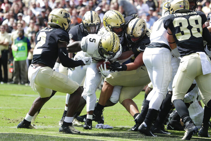 Vanderbilt running back Ke'Shawn Vaughn (5) runs in for a touchdown between Purdue cornerback Kenneth Major (2) and defensive end George Karlaftis (5) during the first half of an NCAA college football game in West Lafayette, Ind., Saturday, Sept. 7, 2019. (AP Photo/Michael Conroy)
