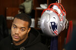 FILE - In this Jan. 18, 2018, file photo, New England Patriots defensive end Trey Flowers faces reporters in the team's locker room following an NFL football practice, in Foxborough, Mass. Defense is the area with the most depth in this year's free agency class, Monday, March 11, 2019. (AP Photo/Steven Senne, File)